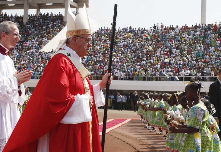 Pope Francis arrives in procession to celebrate Mass at Barthelemy Boganda Stadium in Bangui, Central African Republic, Nov. 30. (CNS photo/Paul Haring)