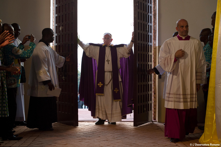 Pope Francis walks through the Holy Door after opening it to begin the Holy Year of Mercy at the start of a Mass with priests, religious, catechists and youths at the cathedral in Bangui, Central African Republic, Nov. 29. (CNS photo/L'Osservatore Romano)