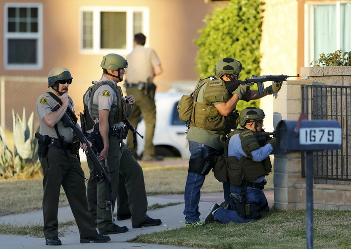 Police officers conduct a manhunt after a mass shooting in San Bernardino, Calif., on Dec. 2. (CNS photo/Mike Blake, Reuters)