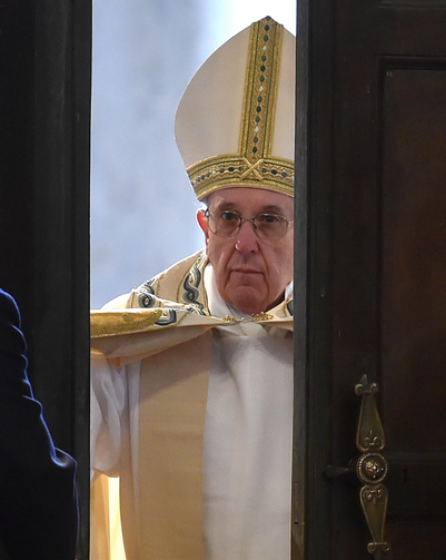 Pope Francis opens the Holy Door of St. Peter's Basilica to inaugurate the Jubilee Year of Mercy at the Vatican Dec. 8. (CNS photo/Ettore Ferrari, EPA)