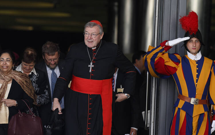 Australian Cardinal George Pell, prefect of the Vatican Secretariat for the Economy, leaves a session of the Synod of Bishops on the family at the Vatican in this Oct. 23 file photo. (CNS photo/Paul Haring)