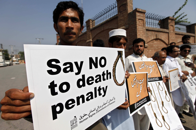 Human rights activists hold placards during a rally in early October against the death penalty in Peshawar, Pakistan. (CNS photo/Arshad Arbab, EPA)
