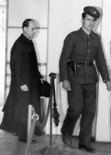 Blessed Alojzije Stepinac enters a Zagreb courtroom in 1946. Stepinac, who has been accused of being a Nazi sympathizer, is currently being studied by Croatian and Serbian experts who hope to clear up questions about his life. (CNS file photo)