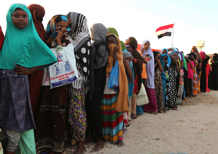 Yemeni refugees wait in line for food rations in December 2015 at a makeshift camp in Somalia's capital, Mogadishu. (CNS photo/Feisal Omar, Reuters)