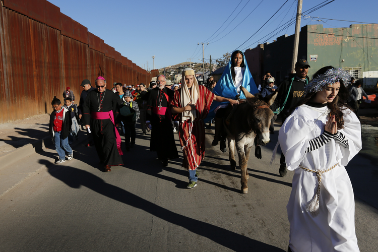 "A ""posada,"" the commemoration of Mary and Joseph's search for shelter, Dec. 20 along the international border fence in Nogales, Sonora. (CNS photo/Nancy Wiechec)"