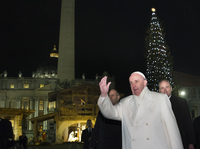 Pope Francis greets the crowd in St. Peter's Square after visiting the Nativity scene in the square on New Year's Eve at the Vatican Dec. 31. (CNS photo/Paul Haring)