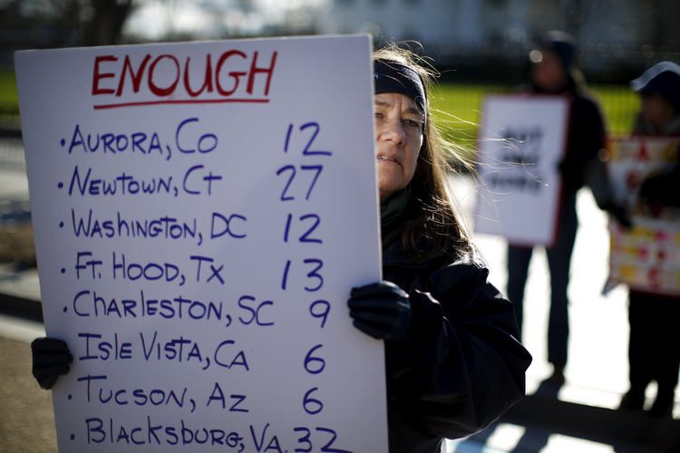 A Grim Tally. Gun control activists rally in front of the White House in Washington on Jan. 4. The next day, President Barack Obama announced executive actions to reduce gun violence.