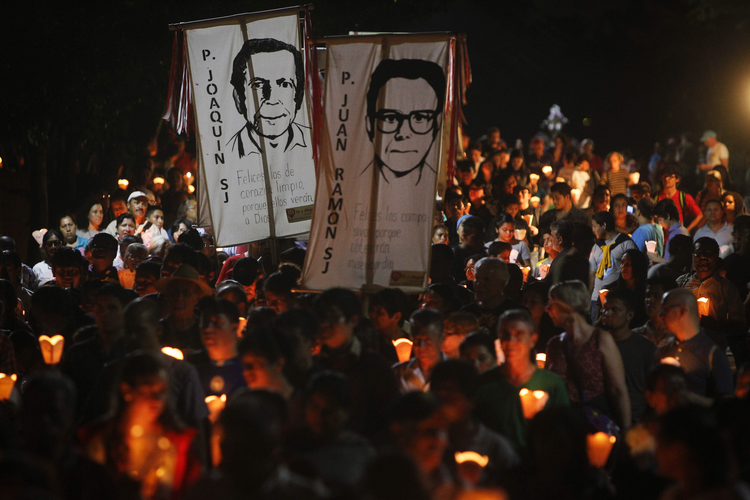 "The ""little lanterns march"" at the Central American University in San Salvador during the 2015 commemoration of the 26th anniversary of the massacre of six Jesuit priests and two women, murdered in November 1989 by a military commando. (CNS photo/Oscar Rivera, EPA)"
