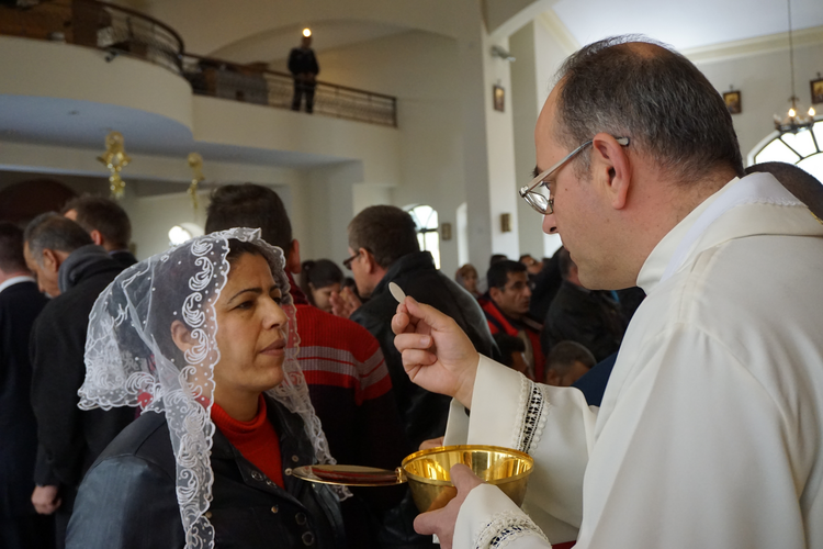 Image: Mass for Iraqi Christian refugees at Our Lady of Peace Center on the outskirts of the Jordanian capital, Amman, in January 2016. (CNS photo/Dale Gavlak)