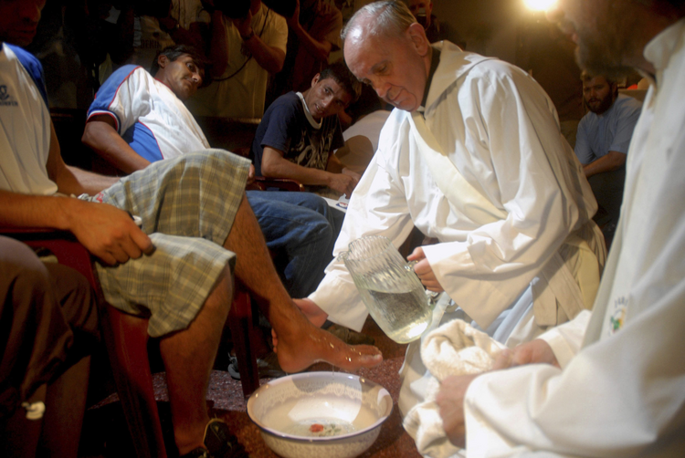 Cardinal Jorge Mario Bergoglio, who became Pope Francis, washes the feet of residents of a shelter for drug users during Holy Thursday Mass at a church in a poor neighborhood of Buenos Aires, Argentina, in 2008. Following a request by Pope Francis, the Vatican issued a decree Jan. 21 specifying that the Holy Thursday foot-washing ritual can include women. (CNS photo/Enrique Garcia Medina, Reuters)