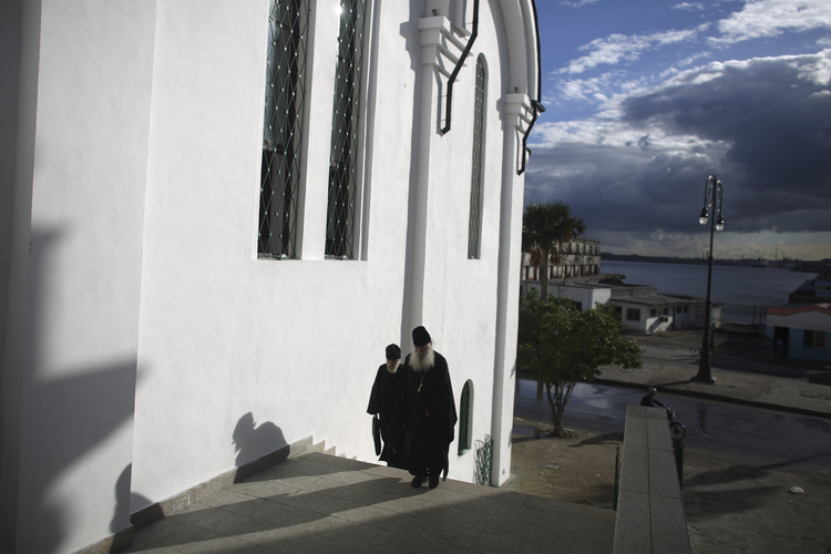 Orthodox priests arrive at the Russian Orthodox church in Havana Feb. 7. Pope Francis and Russian Orthodox Patriarch Kirill will meet in Cuba on Feb. 12. (CNS photo/Alexandre Meneghini, Reuters)