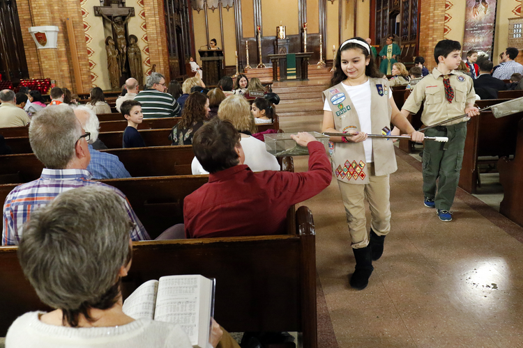 Girl Scout Julia Ocasio, 13, and Boy Scout Thomas Perotta, 10, use collection baskets during a Scout Sunday Mass on Feb. 7 at Immaculate Heart of Mary Church in the Windsor Terrace neighborhood of the New York borough of Brooklyn. (CNS photo/Gregory A. Shemitz)