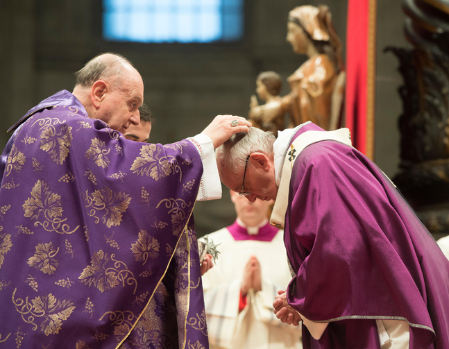 Cardinal Angelo Comastri, archpriest of St. Peter's Basilica, places ashes on Pope Francis' head during Ash Wednesday Mass in St. Peter's Basilica at the Vatican Feb. 10. (CNS photo/Paul Haring)