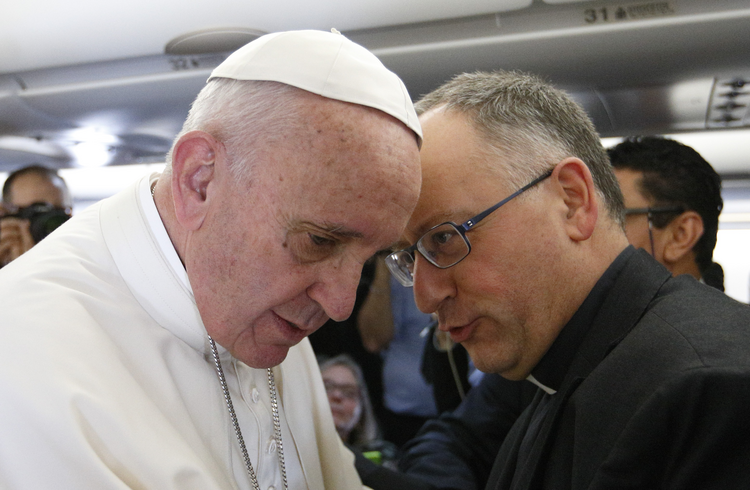 Pope Francis talks with Jesuit Father Antonio Spadaro, editor of La Civilta Cattolica, while meeting journalists aboard his flight to Havana Feb. 12. Traveling to Mexico for a six-day visit, the pope is stopping briefly in Cuba to meet with Russian Orthodox Patriarch Kirill of Moscow at the Havana airport. (CNS photo/Paul Haring)