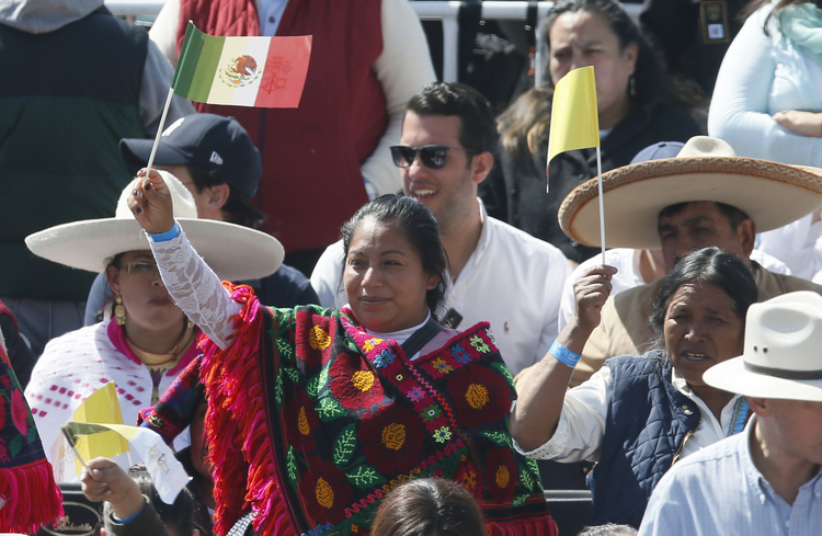 People wave the flags of Mexico and the Vatican as they wait for Pope Francis' arrival to celebrate Mass in Ecatepec near Mexico City Feb. 14. (CNS photo/Paul Haring)