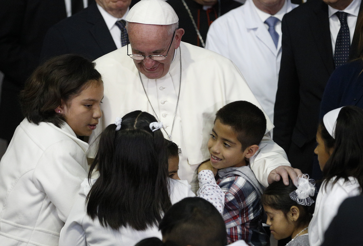 Pope Francis embraces children during a visit to the Federico Gomez Children's Hospital of Mexico in Mexico City Feb. 14. (CNS photo/Paul Haring)