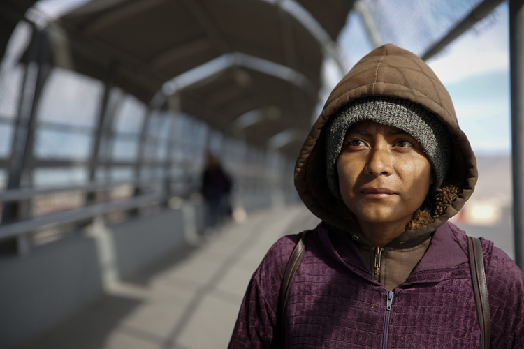 Diana Martinez, who had been deported from the United States, stands on the bridge linking El Paso, Texas, and Juarez, Mexico, in February 2016. (CNS photo/Nancy Wiechec)
