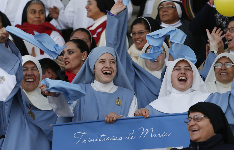 Nuns cheers before Pope Francis' arrival to celebrate Mass with priests and religious at a stadium in Morelia, Mexico, Feb. 16. (CNS photo/Paul Haring)