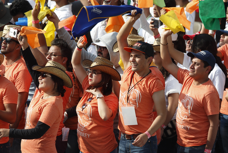 Young people cheer as Pope Francis leads a meets with them at the Jose Maria Morelos Pavon Stadium in Morelia, Mexico, Feb. 16. (CNS photo/Paul Haring)