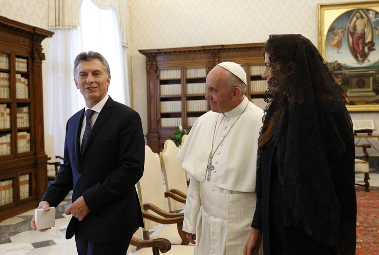 Pope Francis walks with Argentinian President Mauricio Macri and his wife Juliana Awada during a private audience in the Apostolic Palace at the Vatican Feb. 27. (CNS photo/Paul Haring)