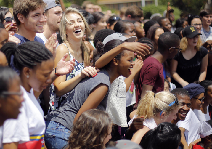 Young people gather for a group photo after a Mass for peace at the University of Pretoria in South Africa Feb. 25. (CNS photo/Kim Ludbrook, EPA)