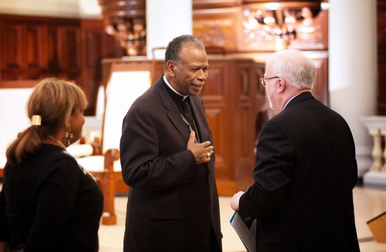 Bishop Edward K. Braxton of Belleville, Ill., greets the Rev. Timothy George, dean of Samford University's Beeson Divinity School. (CNS photo/Mary D. Dillard, One Voice)