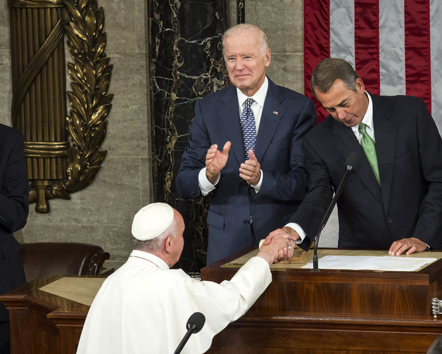 Zip-a-dee-doo-dah Day. U.S. Vice President Joe Biden and then-House Speaker John Boehner greet Pope Francis in Washington in this Sept. 24, 2015, file photo. (CNS photo/Drew Angerer, EPA)