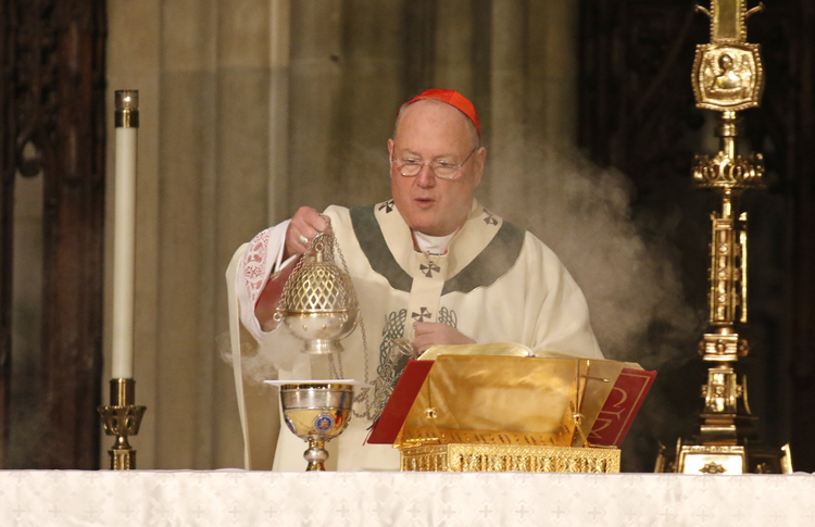 Cardinal Timothy M. Dolan of New York uses a censer while celebrating a St. Patrick's Day Mass March 17, 2017 at St. Patrick's Cathedral in New York City. (CNS photo/Gregory A. Shemitz)