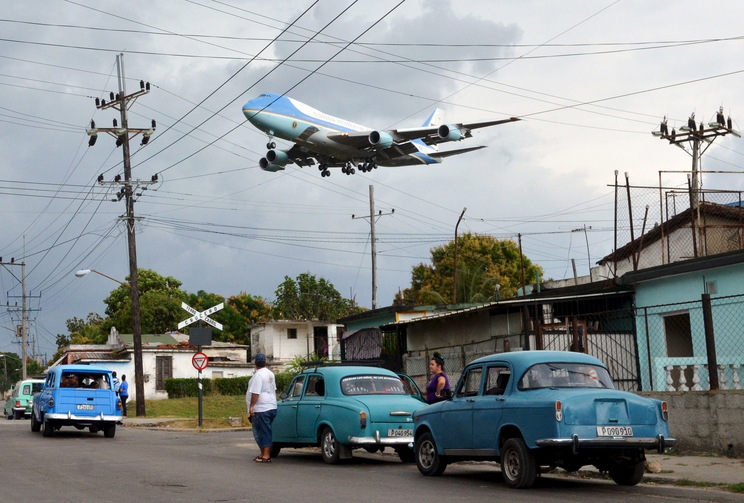 Air Force One carrying U.S. President Barack Obama and his family flies over a Havana neighborhood in Cuba as it approaches the runway March 20. (CNS photo/Alberto Reyes, Reuters)