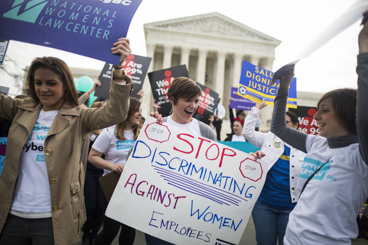 Women lobby in support of the Affordable Care Act's contraceptive mandate on March 23 outside the U.S. Supreme Court ahead of oral arguments in Zubik v. Burwell in Washington. (CNS photo/Jim Lo Scalzo, EPA)