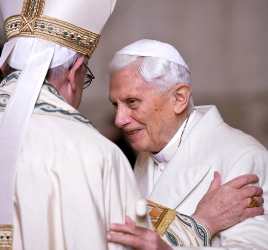 Pope Francis greets retired Pope Benedict XVI prior to the opening of the Holy Door of St. Peter's Basilica at the Vatican in 2015. (CNS photo/Maurizio Brambatti, EPA)