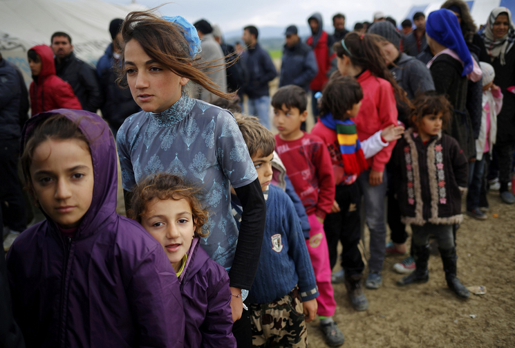 Young refugees wait in line for tea at a makeshift camp April 11 at the Greek-Macedonian border near the village of Idomeni, Greece. Pope Francis will travel to Lesbos, Greece, April 16. (CNS photo/Stoyan Nenov, Reuters)