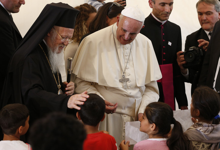 Ecumenical Patriarch Bartholomew of Constantinople and Pope Francis meet children at the Moria refugee camp on the island of Lesbos, Greece, April 16, 2016. (CNS photo/Paul Haring)