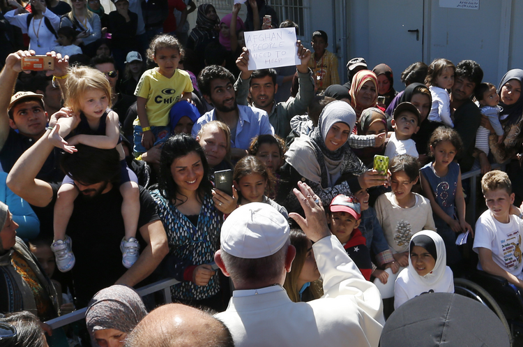 Pope Francis greets refugees at the Moria refugee camp on the island of Lesbos, Greece, April 16, 2016. (CNS photo/Paul Haring)