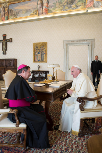 Pope Francis talks with Archbishop Christophe Pierre, the new apostolic nuncio to the United States, during an April 21 meeting at the Vatican. (CNS photo/L'Osservatore Romano)