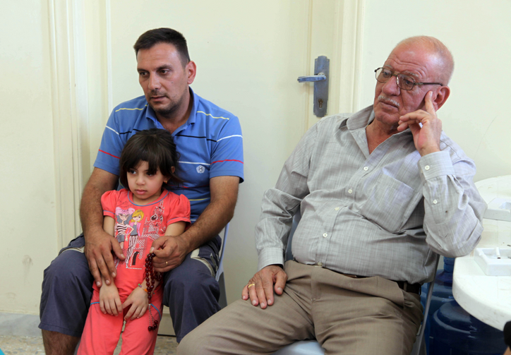 A Christian family who fled violence in Mosul, Iraq. (CNS photo/Jamal Nasrallah, EPA)