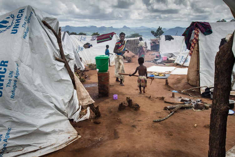 Refugees walk outside their tents in early February 2016 in the Kapise refugee camp in Mwanza, Malawi. (CNS photo/Erico Waga, EPA