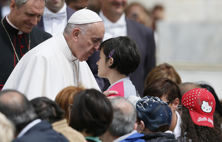 Pope Francis greets a young woman as he meets the disabled during his general audience in St. Peter's Square at the Vatican June 1. (CNS photo/Paul Haring)