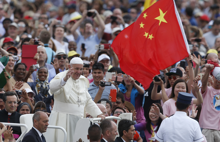 China's flag waves as Pope Francis greets the crowd during his general audience in St. Peter's Square at the Vatican in June. (CNS photo/Paul Haring)