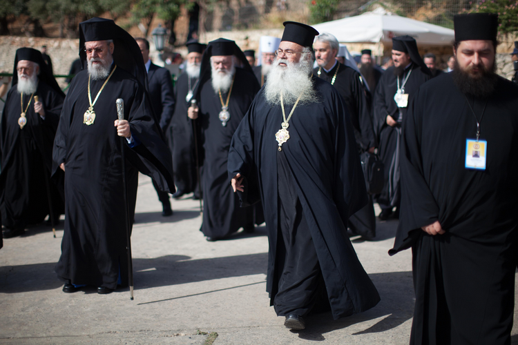 Orthodox patriarchs and primates walk at the Orthodox Academy of Crete as they meet to consider a draft message of the Great and Holy Council of the Orthodox Church in Chania on the Greek island of Crete, June 17 (CNS photo/Sean Hawkey, handout).