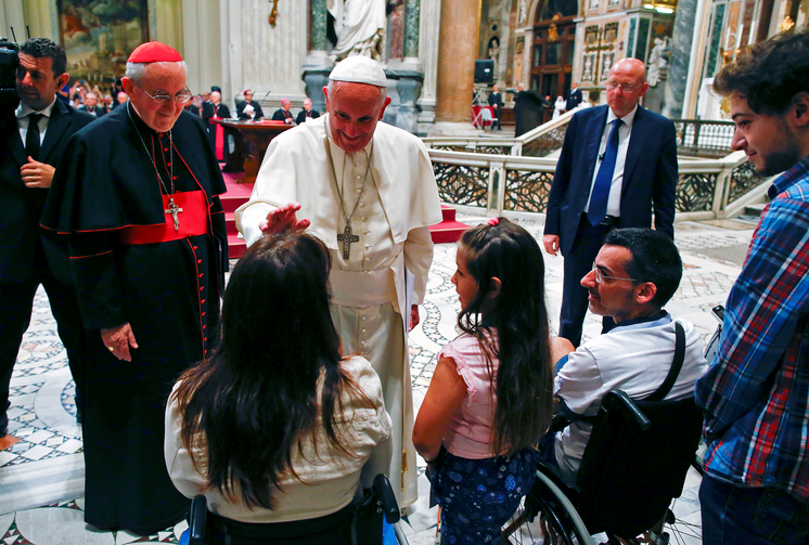 Pope Francis blesses a woman as he meets the disabled during the opening of the Diocese of Rome's annual pastoral conference at the Basilica of St. John Lateran in Rome June 16. (CNS photo/Tony Gentile, Reuters)