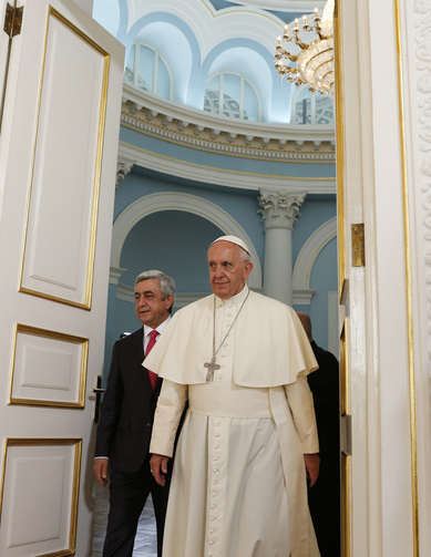 Pope Francis and Armenian President Serzh Sargsyan arrive for a courtesy visit in the presidential palace in Yerevan, Armenia, June 24. (CNS photo/Paul Haring)