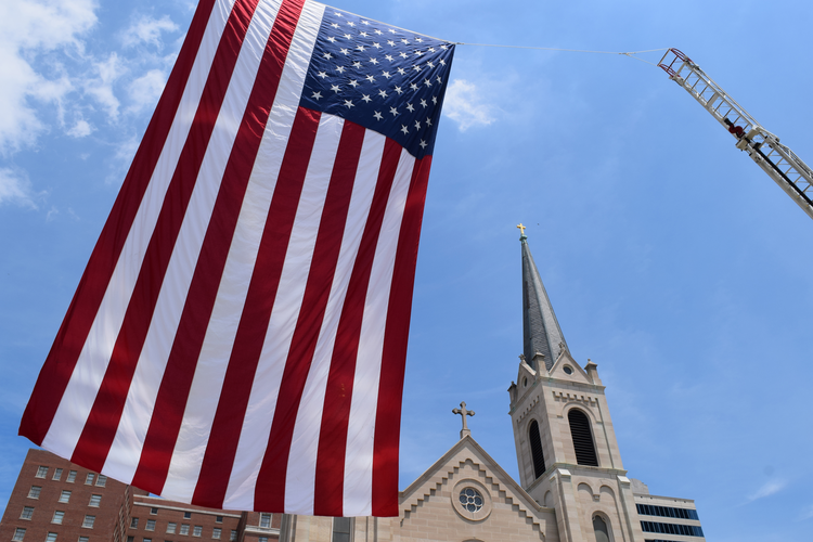 Flagging liberty? Outside Sacred Heart Church in downtown Peoria, Ill, June 2016. (CNS photo/Tom Dermody, Catholic Post)