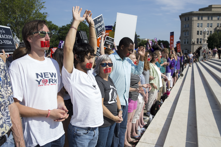Pro-life supporters pray at the steps of the U.S. Supreme Court June 27 during protests in Washington. In a 5-3 vote that day, the U.S. Supreme Court struck down restrictions on Texas abortion clinics. (CNS photo/Michael Reynolds, EPA)