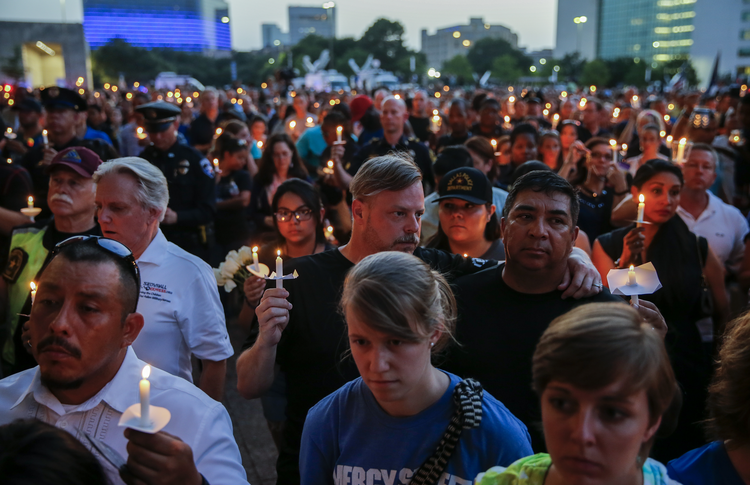 People participate in a candlelight vigil July 11 at the Dallas City Hall Plaza. (CNS photo/Erik S. Lesser, EPA)