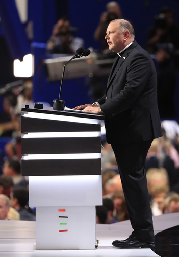 Msgr. Kieran Harrington, vicar of communications for the Diocese of Brooklyn, N.Y., delivers the invocation on July 18 during the first day of the 2016 Republican National Convention in Cleveland. (CNS photo/Tannen Maury, EPA)