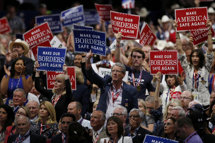 Delegates hold signs calling for border security, a facet of the extremely conservative 2016 platform, during the first day of the Republican National Convention in Cleveland on July 18. (CNS photo/Mario Anzuoni, Reuters)
