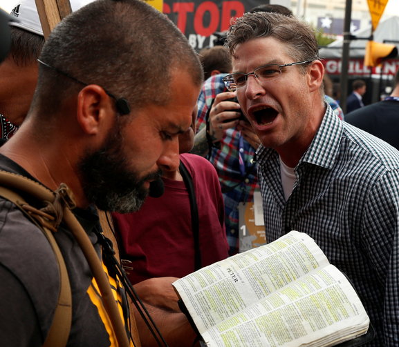 A protester against Donald Trump's candidacy screams at a man reciting passages from Scripture July 18 outside of the Republican National Convention in Cleveland. (CNS photo/Lucas Jackson, Reuters)