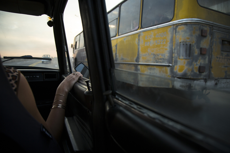 A woman rides in a taxi in Havana on Sept. 21, 2015. (CNS photo/Tyler Orsburn)
