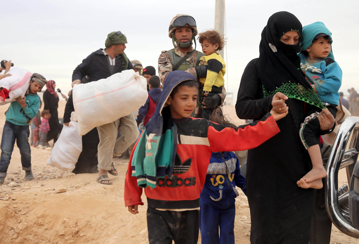 Syrian refugees arrive at a refugee camp in early May at the Jordan border with Syria. The Catholic Church in England and Wales has joined a government project to resettle an estimated 20,000 refugees from the Syrian war. (CNS photo/Jamal Nasrallah, EPA)